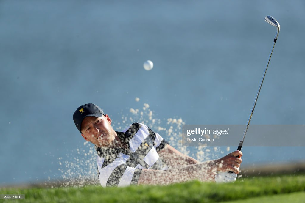Daniel Berger of the United States team plays his third shot on the 14th hole in his match with Brooks Koepka agianst Louis Oosthuizen and Branden Grace of the International Team during the first day foursomes matches for the 2017 Presidents Cup at the Liberty National Golf Club on September 28, 2017 in Jersey City, New Jersey.