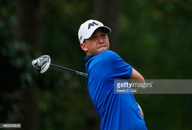 Daniel Berger of the United States watches his tee shot on the 14th hole during the final round of the TOUR Championship By CocaCola at East Lake...