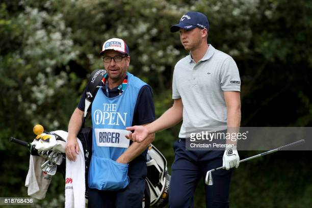 Daniel Berger of the United States with his caddie Grant Berry on the 5th hole during a practice round prior to the 146th Open Championship at Royal...