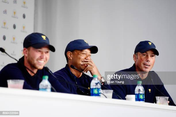 Daniel Berger of the US Team Tiger Woods Captains Assistant of the US Team and Matt Kuchar of the US Team speak to the media during a press...
