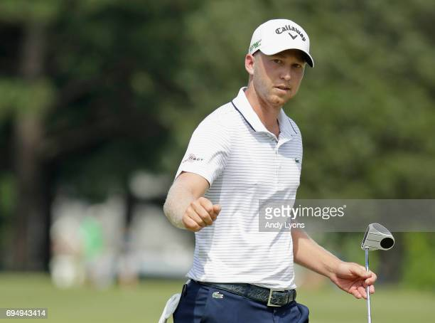 Daniel Berger reacts to his putt on the 16th hole during the final round of the FedEX St Jude Classic at the TPC Southwind on June 11 2017 in Memphis...