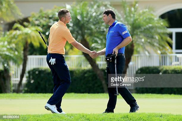 Daniel Berger shakes hands with Padraig Harrington of Ireland on the second playoff hole during the continuation of the fourth round of The Honda...