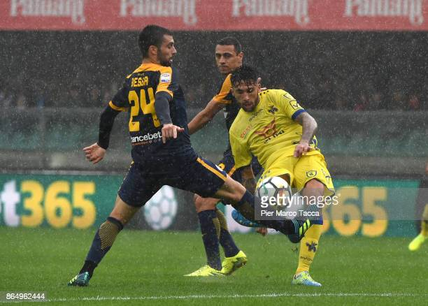 Daniel Bessa of Hella Verona competes for the ball with Lucas Castro of AC Chievo Verona during the Serie A match between AC Chievo Verona and Hellas...