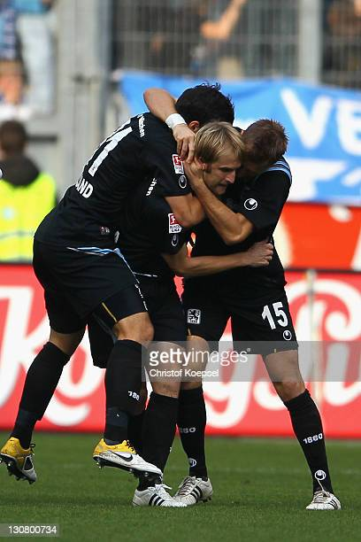 Daniel Bierofka celebrates the first go alwith Sandro Kaiser and Stefan Aigner of Muenchen during the Second Bundesliga match between MSV Duisburg...