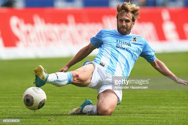 Daniel Bierofka of 1860 Muenchen battles for the ball during the Second Bundesliga League match between 1860 Muenchen and Karlsruher SC at Allianz...