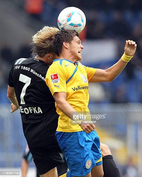 Daniel Bierofka of Muenchen and Mirko Boland of Braunschweig head for the ball during the Second Bundesliga match between Eintracht Braunschweig and...