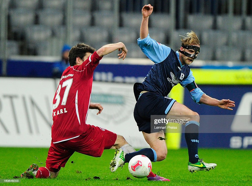 Daniel Bierofka (R) of Muenchen challenges Markus Karl of Kaiserslautern during the Second Bundesliga match between TSV 1860 Muenchen and 1. FC Kaiserslautern at Allianz Arena on February 4, 2013 in Munich, Germany.