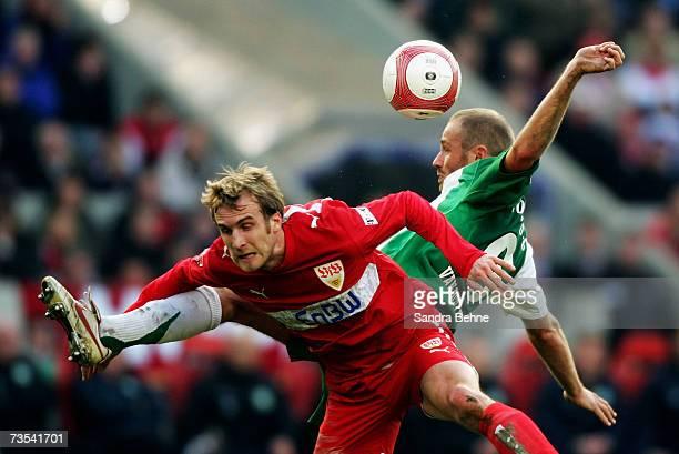 Daniel Bierofka of Stuttgart and Tom van der Leegte of Wolfsburg are seen in action during the Bundesliga match between VfB Stuttgart and VfL...