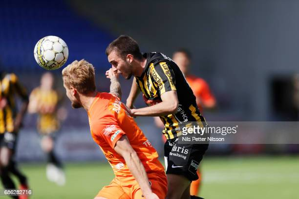 Daniel Bjornkvist of Athletic FC Eskilstuna and Egzon Binaku of BK Hacken competes for the ball during the Allsvenskan match between Athletic...