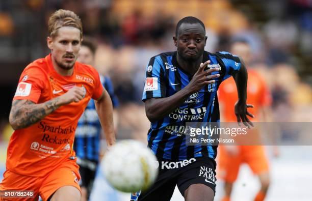 Daniel Bjornkvist of Athletic FC Eskilstuna and Moses Ogbu of IK Sirius FK competes for the ball during the Allsvenskan match between IK Sirius FK...