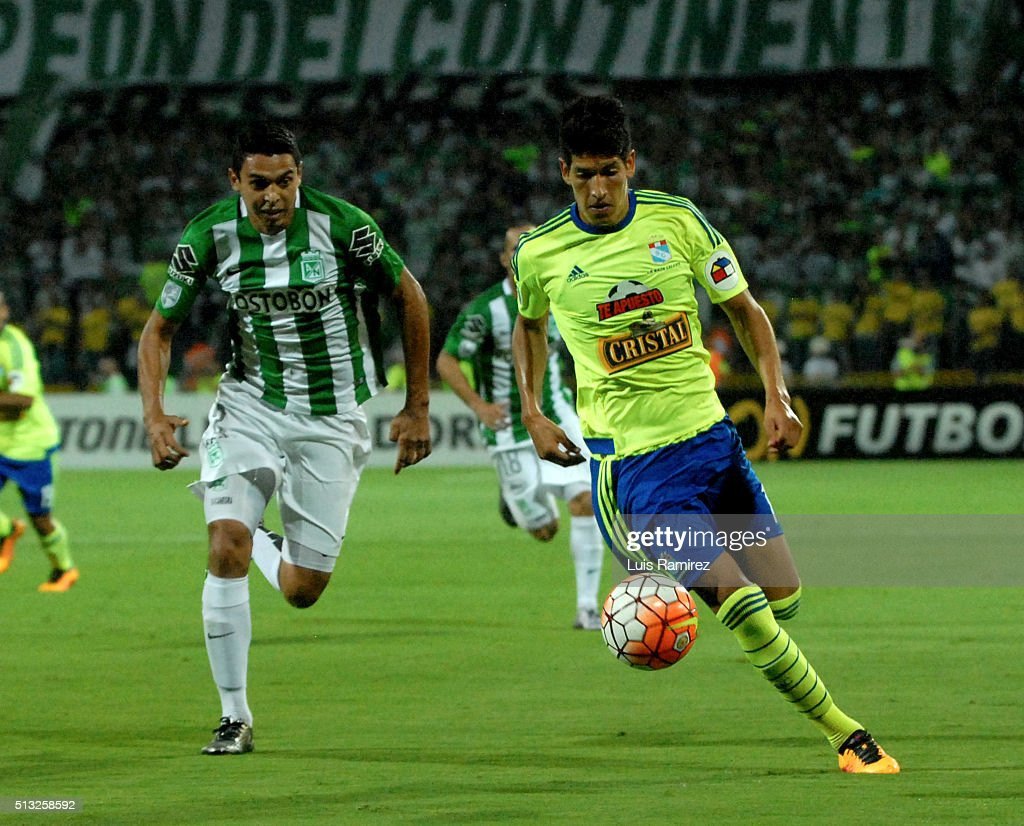 Daniel Bocanegra player of Nacional vies for the ball with Alexis Cossio of Sporting Cristal during a group stage match between Atletico Nacional and Sporting Cristal as part of Copa Libertadores 2016 at Atanasio Girardot Stadium on March 01, 2016 in Medellin, Colombia.