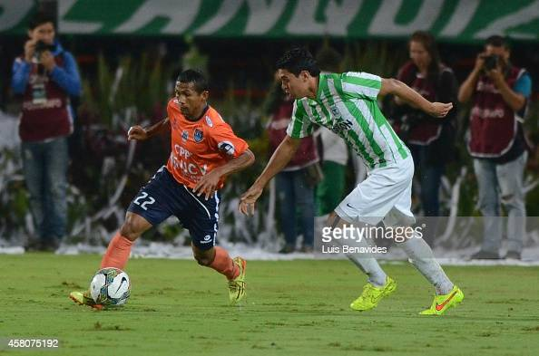 Daniel Bocanegra player of Nacional vies for the ball with William Cheroque of Cesar Vallejo during a first leg match between Atletico Nacional and...