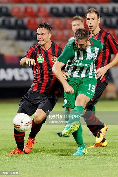 Daniel Bode of Ferencvarosi TC scores a goal between David Bobal of Budapest Honved and Ivan Lovric of Budapest Honved during the Hungarian OTP Bank...