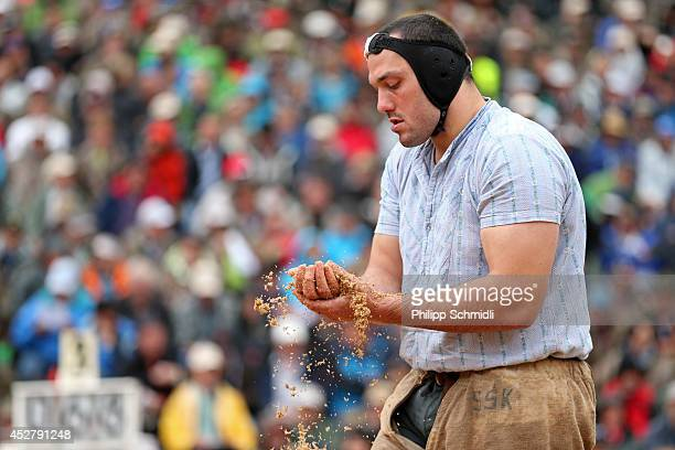 Daniel Boesch prepares his hands prior to his fight during the Alpine Wrestling Festival BruenigSchwinget at the top of the Bruenig Pass on July 27...