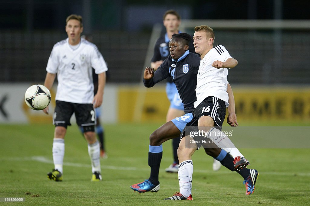 Daniel Bohl (R) of Germany and Blair Turgott (L) of England battle for the ball during the Under 19 international friendly match between Germany and England at Stadion an der Lohmuehle on September 6, 2012 in Luebeck, Germany.