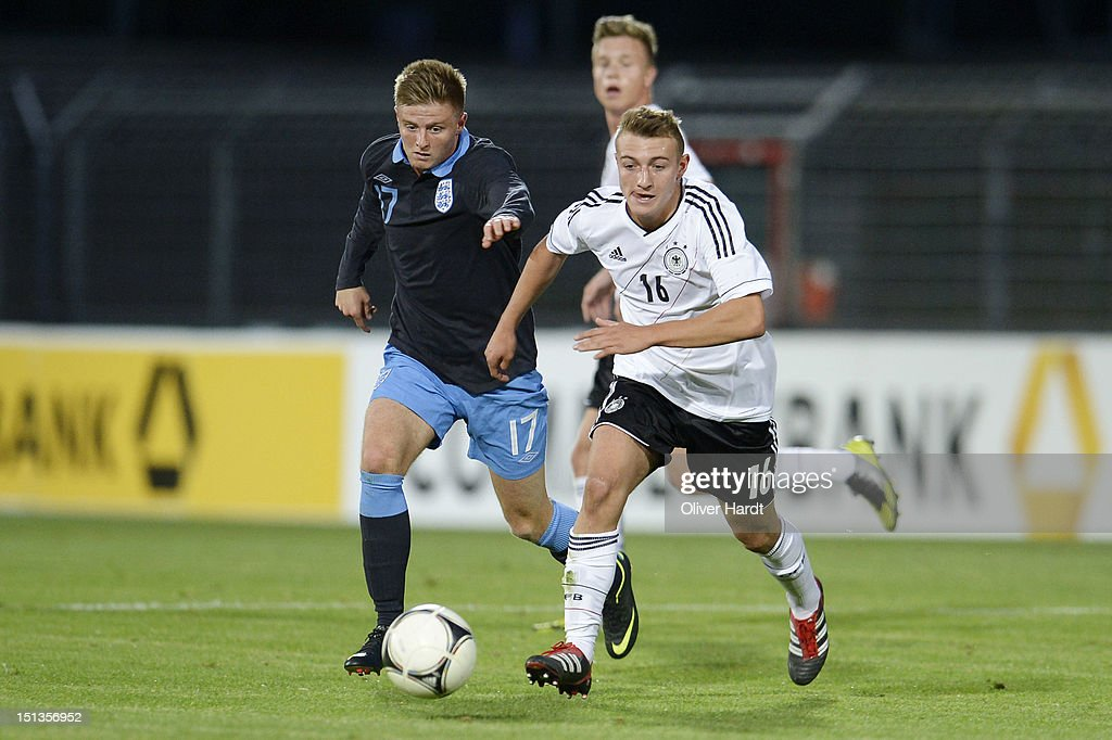 Daniel Bohl (R) of Germany and Jack Barmby (L) of England battle for the ball during the Under 19 international friendly match between Germany and England at Stadion an der Lohmuehle on September 6, 2012 in Luebeck, Germany.