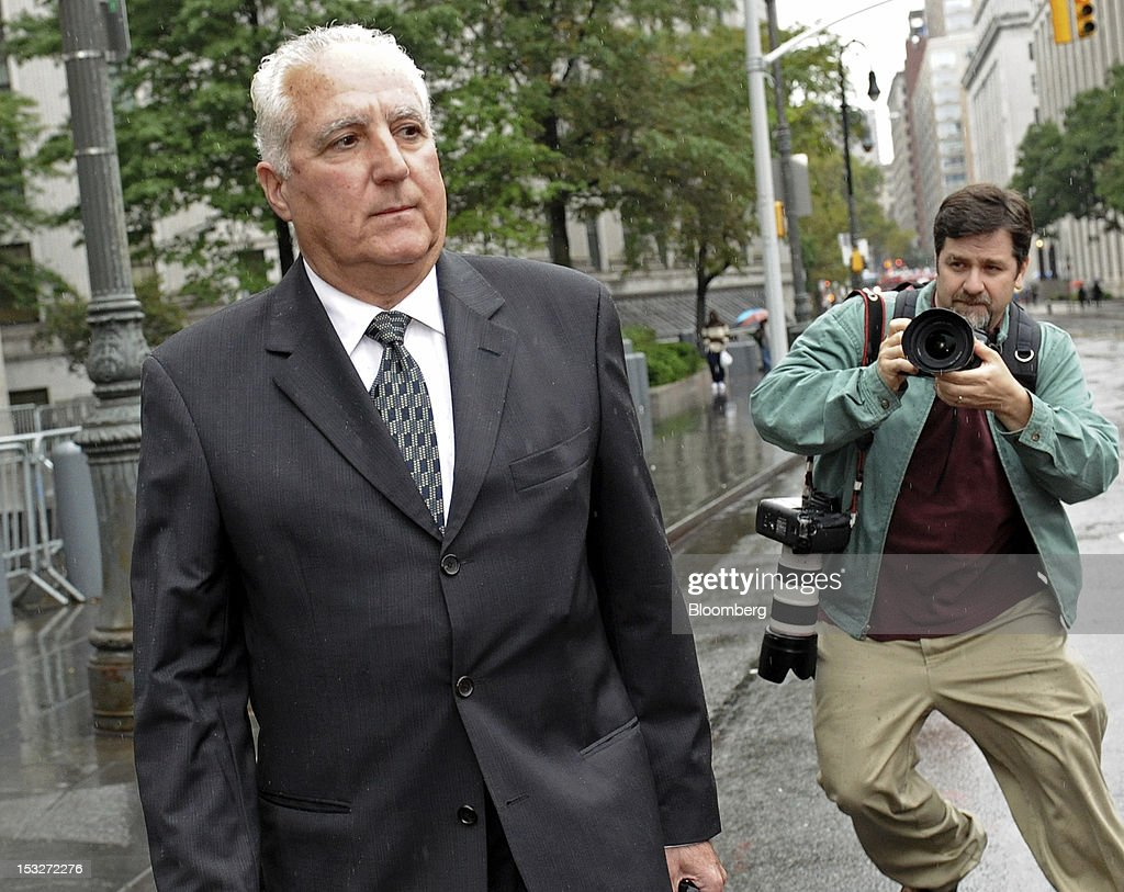 Daniel Bonventre, a former employee at Bernard L. Madoff Investment Securities LLC, exits federal court in New York, U.S., on Tuesday, Oct. 2, 2012. Five longtime employees of Bernard Madoff's former investment firm face more charges related to the jailed con man's Ponzi scheme, which the government claims got its start in the 1970s. Photographer: Louis Lanzano/Bloomberg via Getty Images