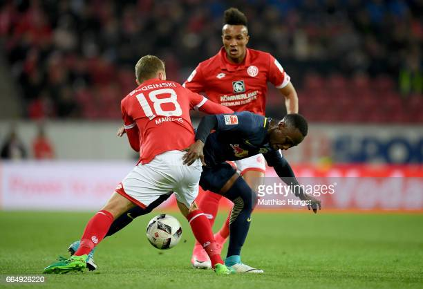 Daniel Borsinski of Mainz and Naby Deco Keita of Leipzig battle for the ball during the Bundesliga match between 1 FSV Mainz 05 and RB Leipzig at...