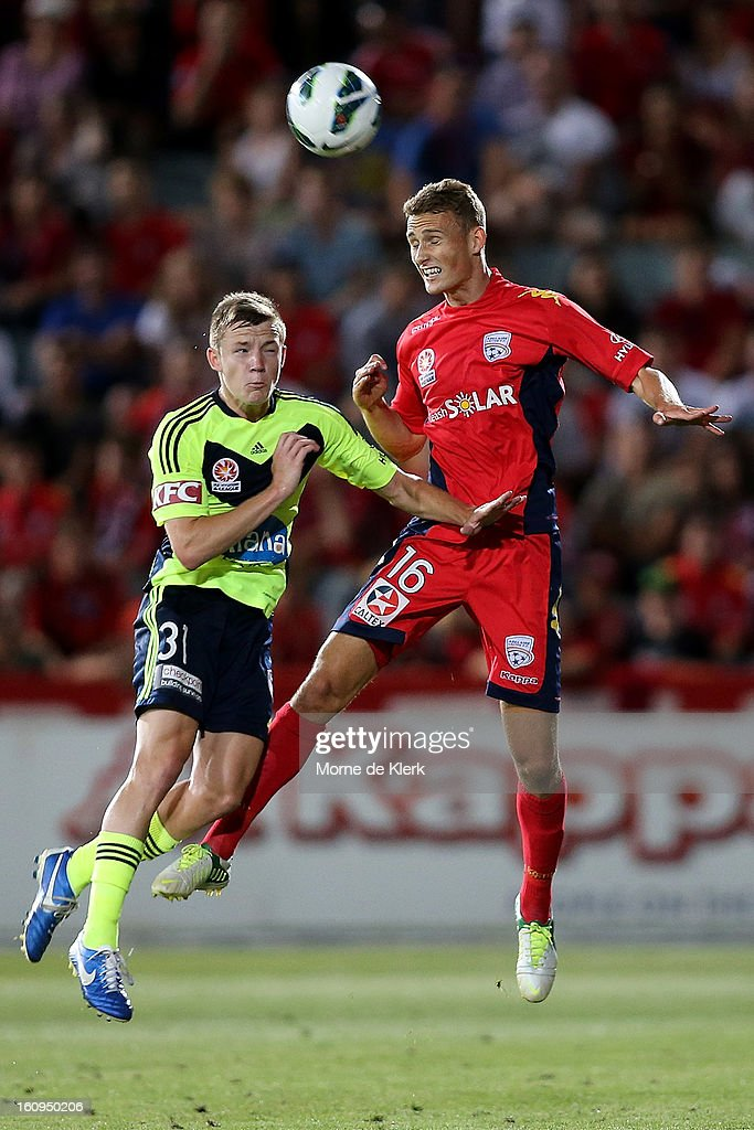 Daniel Bowles of Adelaide competes with Scott Galloway of Melbourne during the round 20 A-League match between Adelaide United and the Melbourne Victory at Hindmarsh Stadium on February 8, 2013 in Adelaide, Australia.
