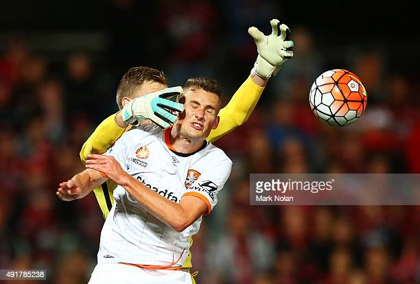 Daniel Bowles of the Roar and Andrew Redmayne of the Wanderers contest possession during the round one ALeague match between the Western Sydney...