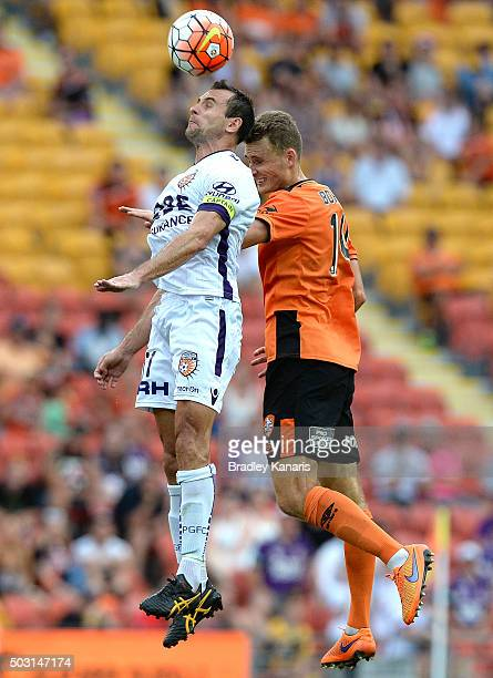 Daniel Bowles of the Roar and Richard Garcia of the Glory challenge for the ball during the round 13 ALeague match between the Brisbane Roar and the...