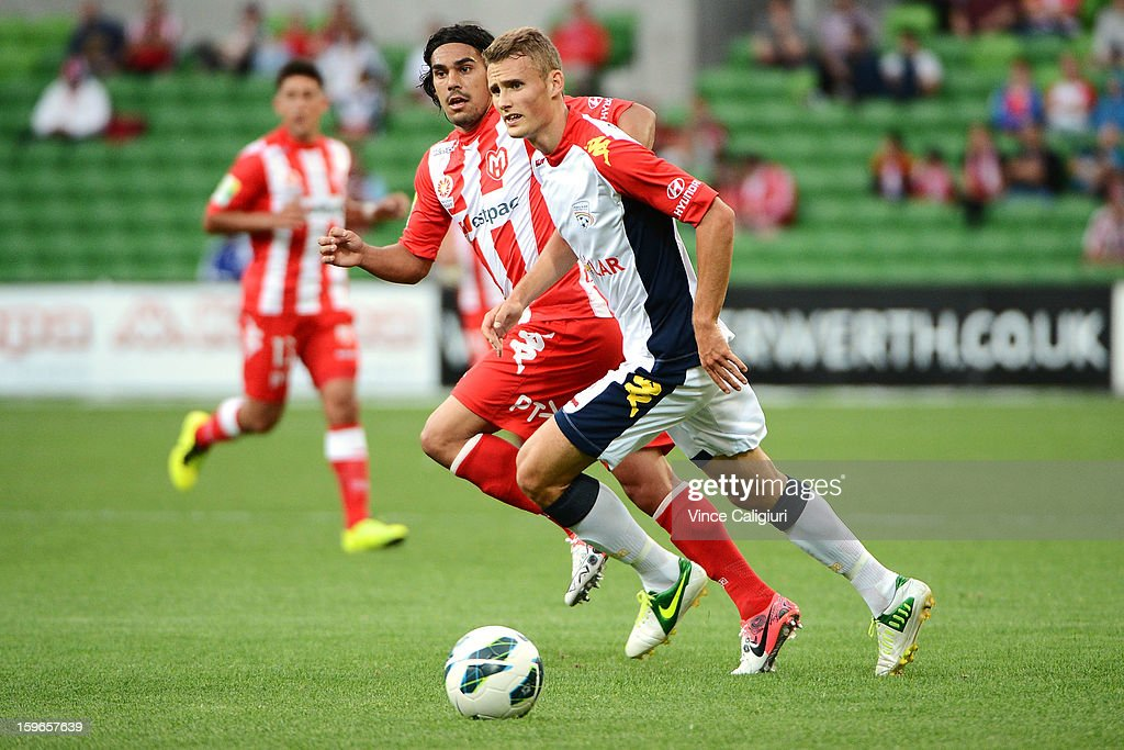 Daniel Bowles of United and David Williams of the Heart contest for the ball during the round seventeen A-League match between Melbourne Heart and Adelaide United at AAMI Park on January 18, 2013 in Melbourne, Australia.