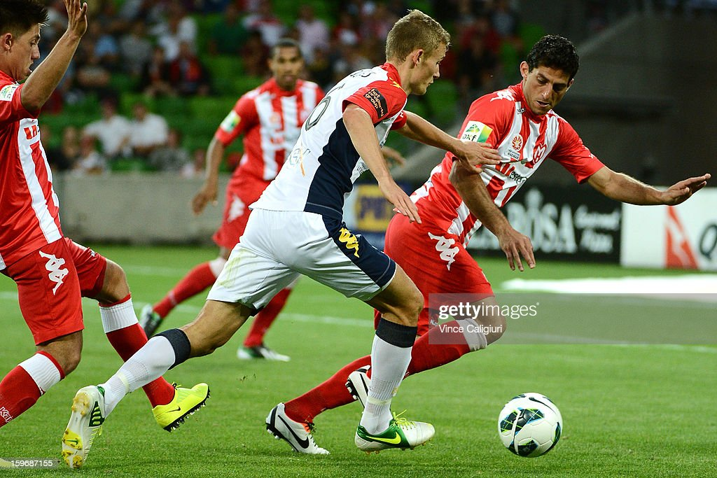 Daniel Bowles of United and Simon Colosimo of the Heart contest for the ball during the round seventeen A-League match between Melbourne Heart and Adelaide United at AAMI Park on January 18, 2013 in Melbourne, Australia.
