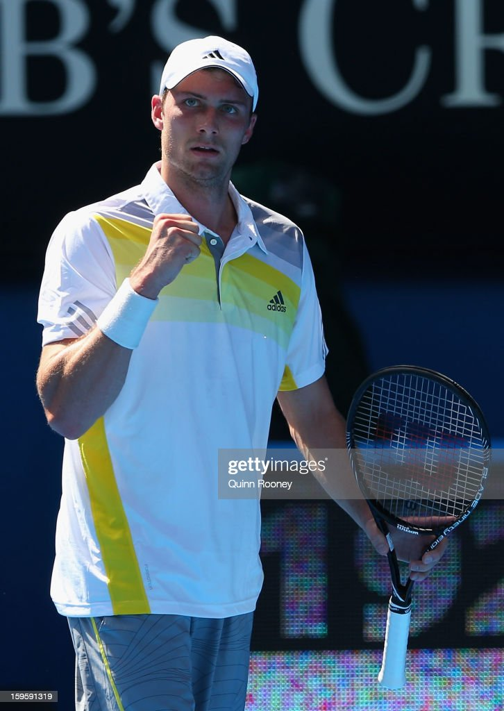 Daniel Brands of Germany celebrates a point in his second round match against Bernard Tomic of Australia during day four of the 2013 Australian Open...