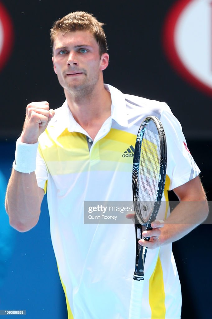 Daniel Brands of Germany celebrates winning the first set in his second round match against Bernard Tomic of Australia during day four of the 2013...