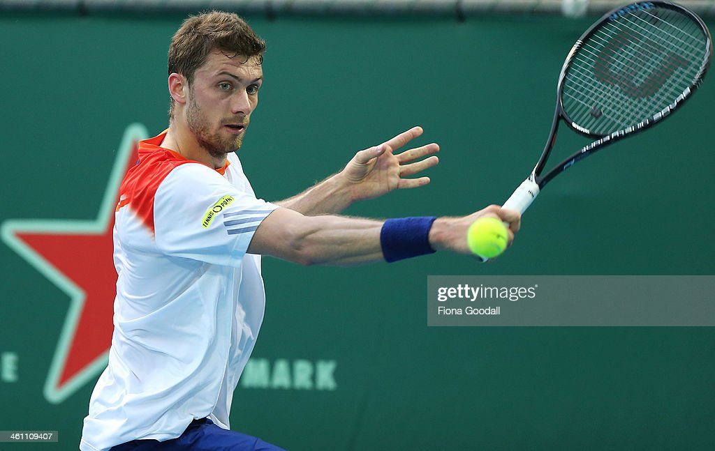 Daniel Brands of Germany hits a shot against Bradley Klahn of USA before rain interrupted play in the second set during day two of the Heineken Open...