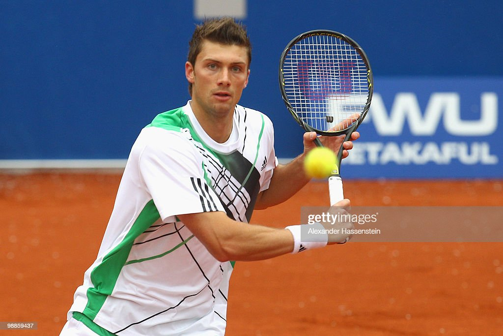 Daniel Brands of Germany plays a backhand during his match against Philipp Kohlschreiber of Germany at day 4 of the BMW Open at the Iphitos tennis...