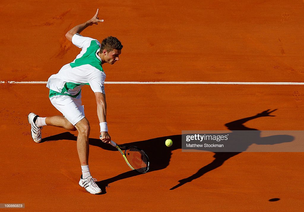 Daniel Brands of Germany plays a backhand during the men's singles first round match between JoWilfried Tsonga of France and Daniel Brands of Germany...