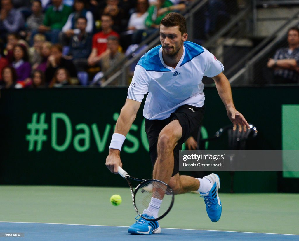 <a gi-track='captionPersonalityLinkClicked' href=/galleries/search?phrase=Daniel+Brands&family=editorial&specificpeople=4273085 ng-click='$event.stopPropagation()'>Daniel Brands</a> of Germany plays a backhand in his match against Roberto Bautista Agut of Spain on day 3 of the Davis Cup First round match between Germany and Spain at Fraport Arena on February 2, 2014 in Frankfurt am Main, Germany.