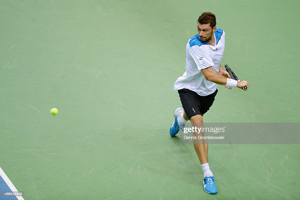 Daniel Brands of Germany plays a backhand in his match against Roberto Bautista Agut of Spain on day 3 of the Davis Cup First round match between...
