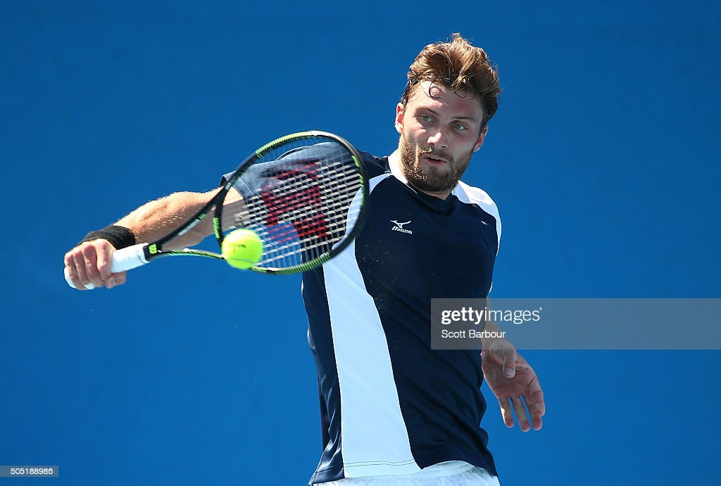Daniel Brands of Germany plays a backhand in his match against James McGee of Ireland during the third round of 2016 Australian Open Qualifying at...