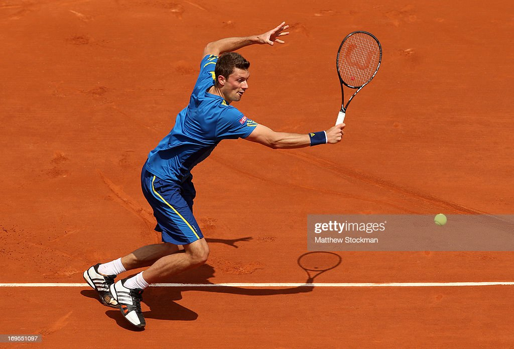 Daniel Brands of Germany plays a backhand in his Men's Singles match against Rafael Nadal of Spain during day two of the French Open at Roland Garros...