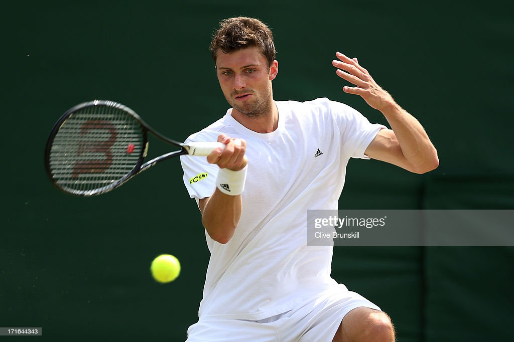 Daniel Brands of Germany plays a forehand during his Gentlemen's Singles second round match against Tomas Berdych of Czech Republic on day four of...