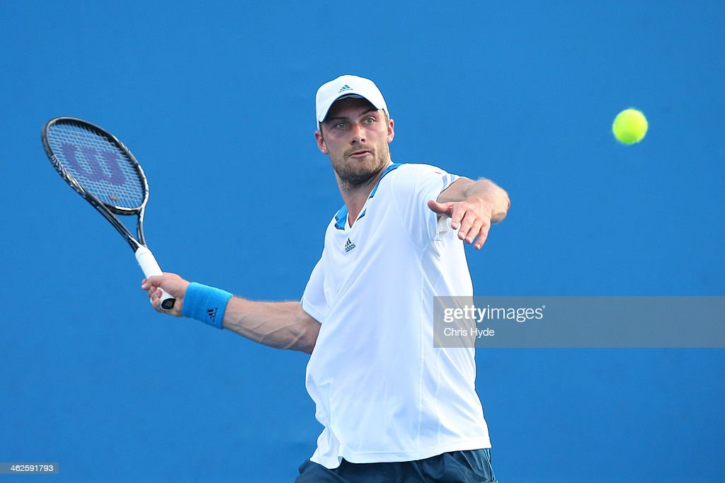 Daniel Brands of Germany plays a forehand in his first round match against Gilles Simon of France during day two of the 2014 Australian Open at...