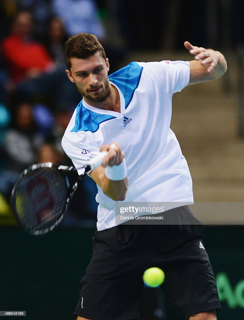 Daniel Brands of Germany plays a forehand in his match against Roberto Bautista Agut of Spain on day 3 of the Davis Cup First round match between...