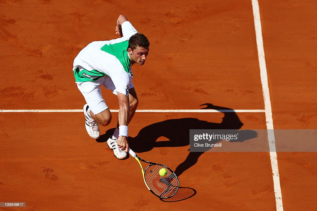 Daniel Brands of Germany plays a volley during the men's singles first round match between JoWilfried Tsonga of France and Daniel Brands of Germany...