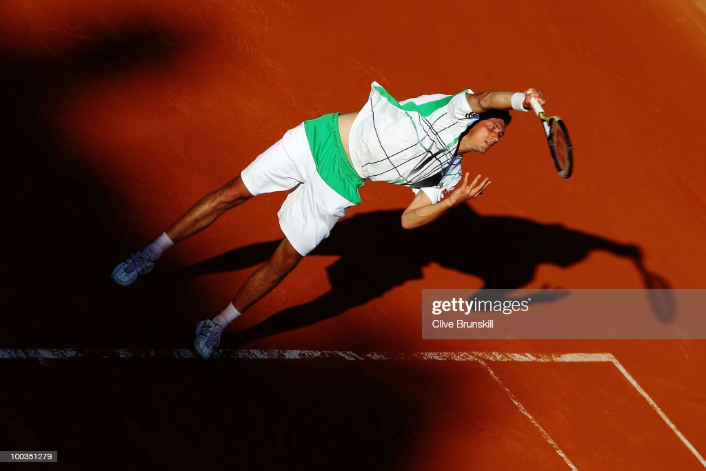 Daniel Brands of Germany serves during the men's singles first round match between JoWilfried Tsonga of France and Daniel Brands of Germany at the...