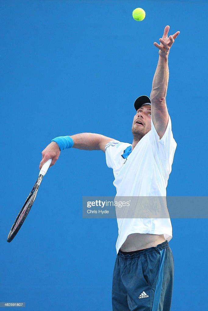 Daniel Brands of Germany serves in his first round match against Gilles Simon of France during day two of the 2014 Australian Open at Melbourne Park...