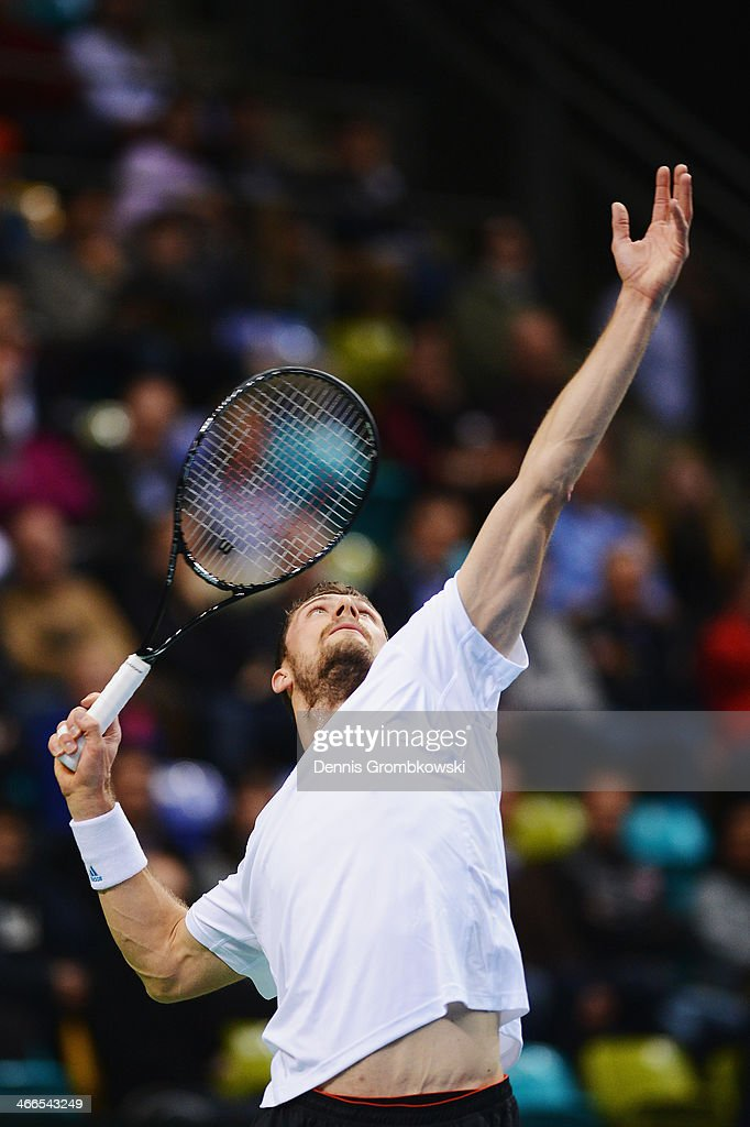 Daniel Brands of Germany serves in his match against Roberto Bautista Agut of Spain on day 3 of the Davis Cup First round match between Germany and...