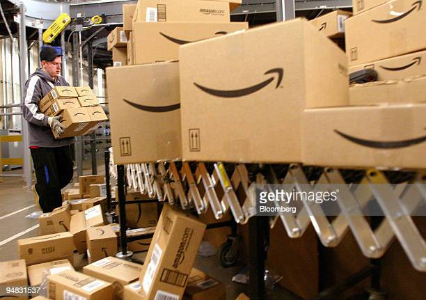 Daniel Brendoff sorts boxes before loading them onto trucks for shipping at Amazoncom's fulfillment Center in Fernley Nevada on Tuesday December 13...