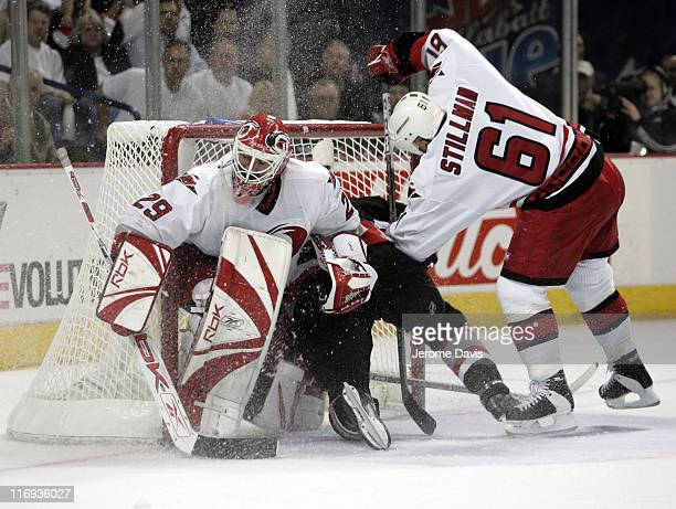 Daniel Briere of the Buffalo Sabres crashes into the net behind Hurricanes goalie Martin Gerber and Cory Stillman during game 3 of the Eastern...