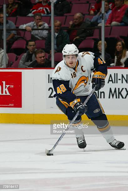 Daniel Briere of the Buffalo Sabres skates with the puck against the New Jersey Devils on December 12 2006 at Continental Airlines Arena in East...