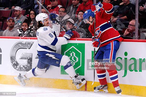 Daniel Briere of the Montreal Canadiens avoids a body check by Mark Barberio of the Tampa Bay Lightning during the NHL game at the Bell Centre on...