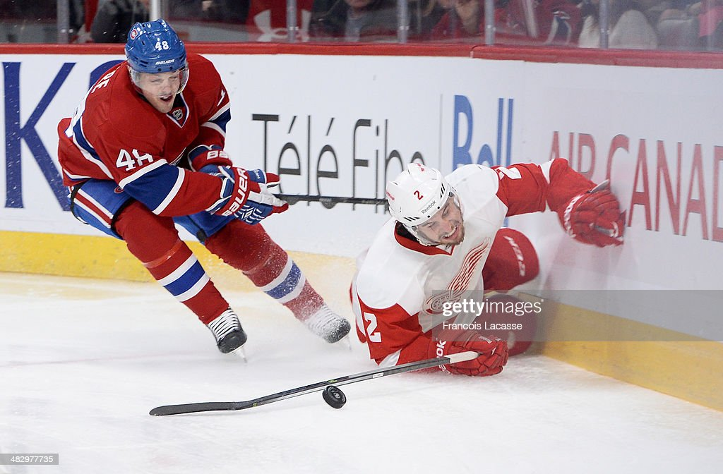 <a gi-track='captionPersonalityLinkClicked' href=/galleries/search?phrase=Daniel+Briere&family=editorial&specificpeople=201624 ng-click='$event.stopPropagation()'>Daniel Briere</a> #48 of the Montreal Canadiens fights for the puck against Brendan Smith #2 of the Detroit Red Wings during the NHL game on April 5, 2014 at the Bell Centre in Montreal, Quebec, Canada.