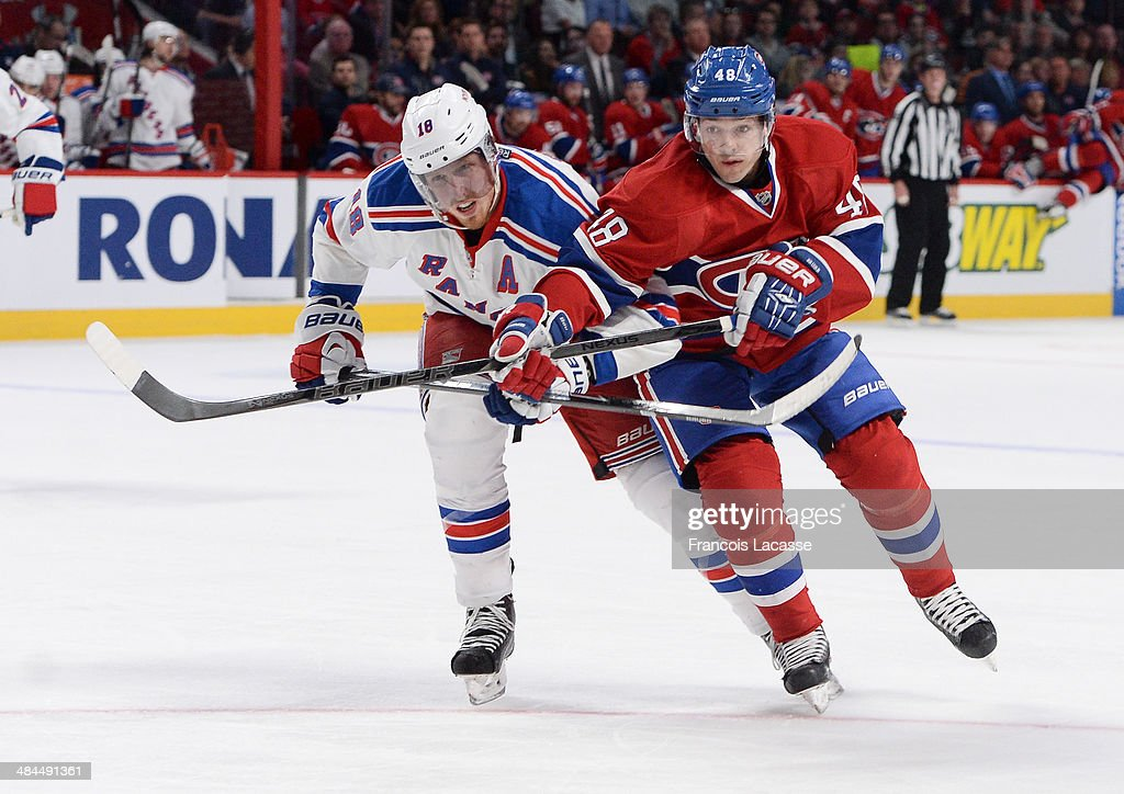 <a gi-track='captionPersonalityLinkClicked' href=/galleries/search?phrase=Daniel+Briere&family=editorial&specificpeople=201624 ng-click='$event.stopPropagation()'>Daniel Briere</a> #48 of the Montreal Canadiens fights for the puck against <a gi-track='captionPersonalityLinkClicked' href=/galleries/search?phrase=Marc+Staal&family=editorial&specificpeople=3809026 ng-click='$event.stopPropagation()'>Marc Staal</a> #18 of the New York Rangers during the NHL game on April 12, 2014 at the Bell Centre in Montreal, Quebec, Canada.