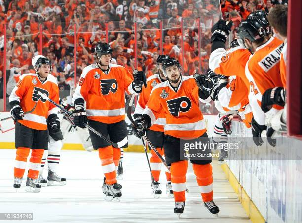 Daniel Briere of the Philadelphia Flyers celebrates assisting on a goal by Scott Hartnell against Chicago Blackhawks during the third period of Game...